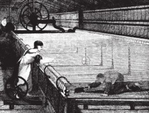 A 'scavenger' sweeping cotton fluff from under a spinning mule.